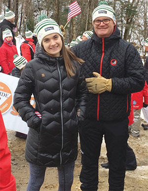 Taylor and her dad, Dave, participating in the VARA World Cup Parade as part of the Quechee Ski Team at Killington