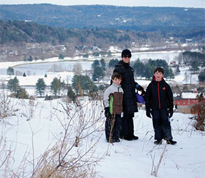 From left: Juan, Juanita and Liam skiing at Quechee