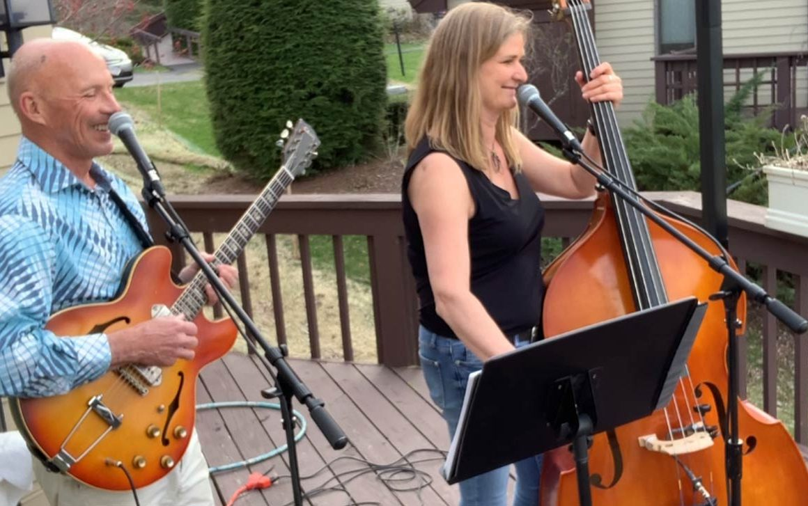 Rowley Hazard and Madonna Gordon of the Mad Hazard Band, play for a live – albeit socially distanced – audience from the back deck of their condo once the weather warmed up.