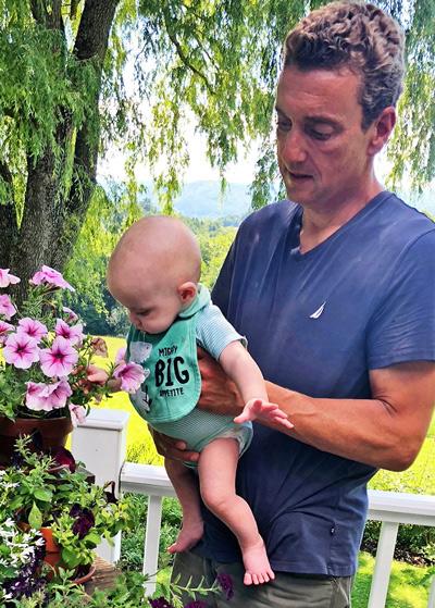 John with 10-month-old grandson, Blake.