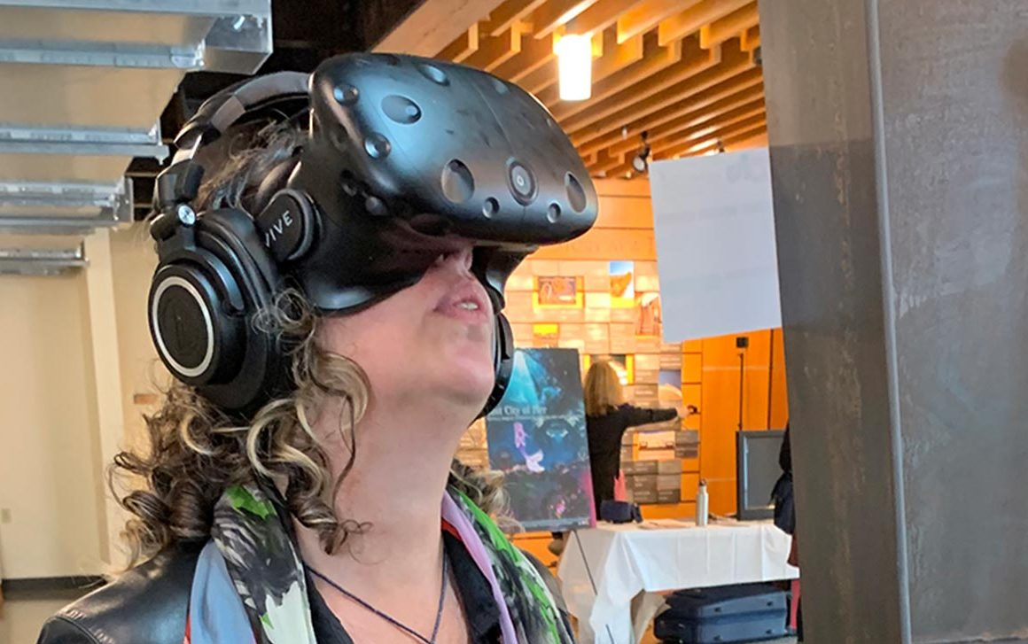 Kim Souza (owner of Revolution, Hartford Select Board member) trying a virtual reality exhibit at WRIF in 2019