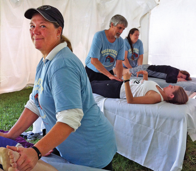 Shelly Yusko donates her time to ease runners' sore muscles after the Covered Bridges Half Marathon.
