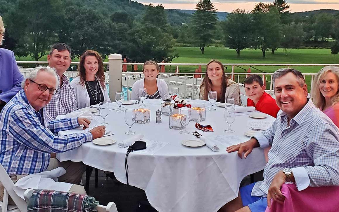 Rich Mauch and his wife Helen (right) join his parents (left), brother, and family for his father's 80th birthday gathering at Dewey's Deck.